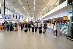 People visit departure hall in international Schiphol airport Stock Image