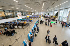 People visit departure hall in international Schiphol airport Royalty Free Stock Photo