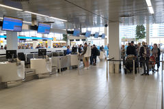 People visit departure hall in international Schiphol airport Royalty Free Stock Images