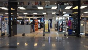 People visit duty free shop in Vnukovo airport at evening stock video footage