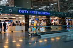 People visit duty free shop in Vnukovo airport at evening Stock Photo