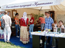 People visit an exhibition of vintage objects. Royalty Free Stock Photo