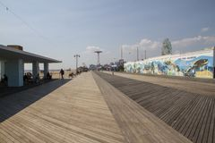 People visit famous old promenade at Coney Island, the amusement beach zone of New York royalty free stock image