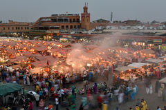 People visit the Jemaa el Fna Square at sunset Royalty Free Stock Images