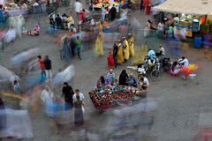 People visit the Jemaa el Fna Square at sunset Stock Photography