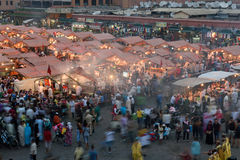 People visit the Jemaa el Fna Square at sunset Stock Photos