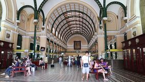 People visit Main Post Office in Ho Chi Minh stock footage