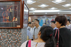 People visit minority culture exhibition Royalty Free Stock Images