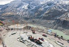 People visit observation platform of Grossglockner Pasterze Glacier in Austria. Royalty Free Stock Images