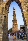 People visit Qutb Minar, Delhi, the worlds tallest brick built m Stock Photography