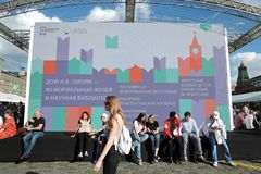 People visit The Red Square Book Fair in Moscow. stock image