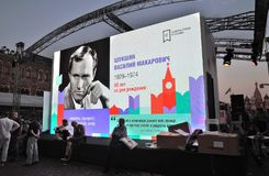 People visit The Red Square Book Fair in Moscow. Place: Moscow, Red Square. Free entrance public event. Color photo. Date: June 06, 2019 royalty free stock photography