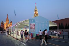People visit The Red Square Book Fair in Moscow. Place: Moscow, Red Square. Free entrance public event. Color photo. Date: June 06, 2019 stock photography