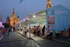 People visit The Red Square Book Fair in Moscow. Place: Moscow, Red Square. Free entrance public event. Color photo. Date: June 06, 2019 stock photo
