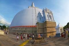 People visit Ruwanwelisaya stupa in Anuradhapura, Sri Lanka. Stock Image