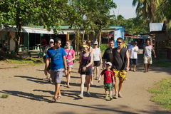 People visit small town of Tortuguero, Costa Rica. TORTUGUERO, COSTA RICA - JUNE 20, 2012: Unidentified people visit small town of Tortuguero, Costa Rica stock image