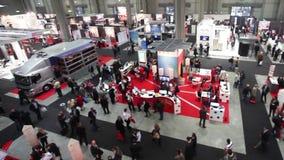 People visit SMAU, panoramic view. People visit SMAU trade show in Milano, Italy stock video
