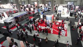 People visit SMAU, panoramic view. People visit SMAU trade show in Milano, Italy stock video footage
