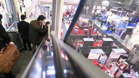 People visit SMAU, panoramic view stock video