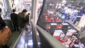 People visit SMAU, panoramic view stock footage