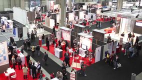 People visit SMAU, timelapse stock video