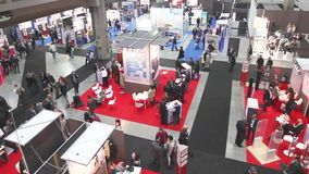 People visit SMAU. Trade show in Milano, Italy stock footage