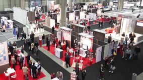 People visit SMAU stock footage