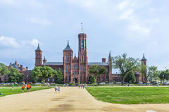 People visit Smithsonian Castle in Washington DC Stock Images