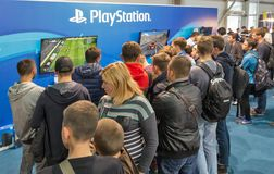 Sony PlayStation booth during CEE 2017 in Kiev, Ukraine. People visit Sony PlayStation home video game console company booth during CEE 2017, the largest stock image
