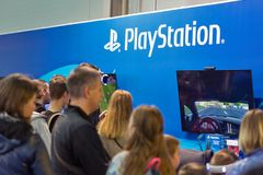 Sony PlayStation booth during CEE 2017 in Kiev, Ukraine. People visit Sony PlayStation home video game console company booth during CEE 2017, the largest Stock Images