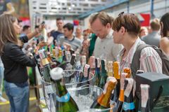 Kyiv Wine Festival by Good Wine in Ukraine. People visit sparkling wine booth at Kyiv Wine Festival. 77 winemakers from around the world took part in the big Stock Photography