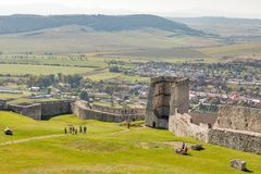 People visit Spis Castle in Spisske Podhradie, Slovakia. Unrecognized people visit Spis Castle courtyard. Spissky hrad, National Cultural Monument UNESCO, is stock photo