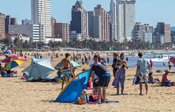 People on Visit to Beach Against Durban City Skyline Royalty Free Stock Photo