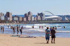 People on Visit to Beach Against Durban City Skyline Royalty Free Stock Photography