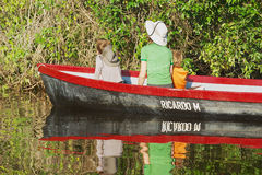 People visit Tortuguero National Park by boat in Tortuguero, Costa Rica. Royalty Free Stock Photo
