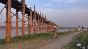 People visit the Ubein bridge in Mandalay, Myanmar.  stock footage