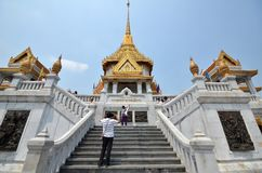 People visit Wat Traimit Stock Image