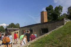 People visiting Auschwitz I camp's gas chamber Stock Photography