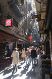 People visiting the bars in a laneway Stock Photography