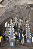 People visiting the Bone church Kostnice. Kostnice, Bone Church, in Kutna hora (Czech republic) is one of the most well known churches in Czech republic. It stock photo