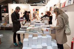 People visiting bookstore at Miart 2014 in Milan Royalty Free Stock Photo
