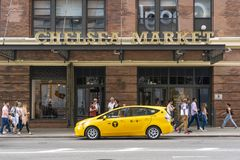 People visiting Chelsea Market in New York City. New York, USA - May 27, 2018: People visiting Chelsea Market in New York City. It is a food hall and shopping royalty free stock photo