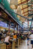 People visiting and eating in the famous central market of Florence called `Mercato centrale`. Florence, Tuscany, Italy. May 22, 2017: People visiting and eating Stock Images