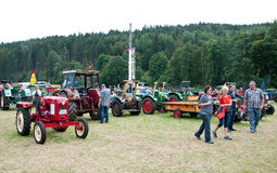 People visiting exibition of old agricultural machinery Royalty Free Stock Image