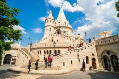 People visiting the Fisherman`s Bastion in Budapest,Hungary. BUDAPEST, HUNGARY,- MAY 11,2018: People visiting the Fisherman`s Bastion at the heart of Buda`s stock photos