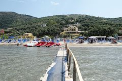 People visiting the floating pier at Kalamaki beach at Corfu Isl royalty free stock photo