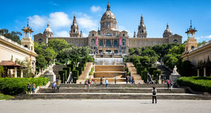 People are visiting Fountain and National Museum of Catalonia at Montjuic hill in Barcelona, Placa De Espanya, Spain. Royalty Free Stock Photography
