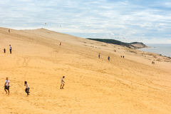 People visiting the highest sand dune of Pyla in Europe Royalty Free Stock Photography