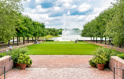 People visiting Lake with Fountain at Chicago Botanic Garden. stock image