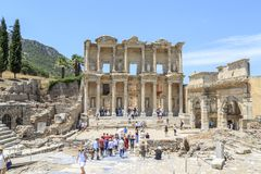 People are visiting library of Celsus in ancient city Ephesus. Ephesus, Izmir, Turkey - July 8, 2018 : People are visiting library of Celsus in ancient city royalty free stock photo